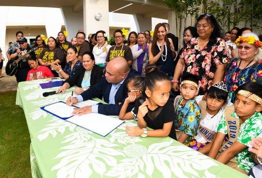 Acting Gov. Josh Tenorio signs a proclamation to kick off the island's celebration of Mes CHamoru, or CHamoru Month at the Senator Antonio M. Palomo Guam Museum & Educational Facility in Hagåtña on Friday, March 1, 2019.