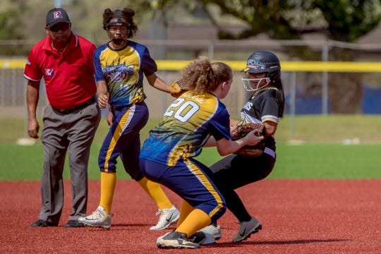 Haile Quintanilla of Tiyan HIgh School steals second base ahead of Guam High's tag during an IIAAG Girls Softball game March 2, 2019.