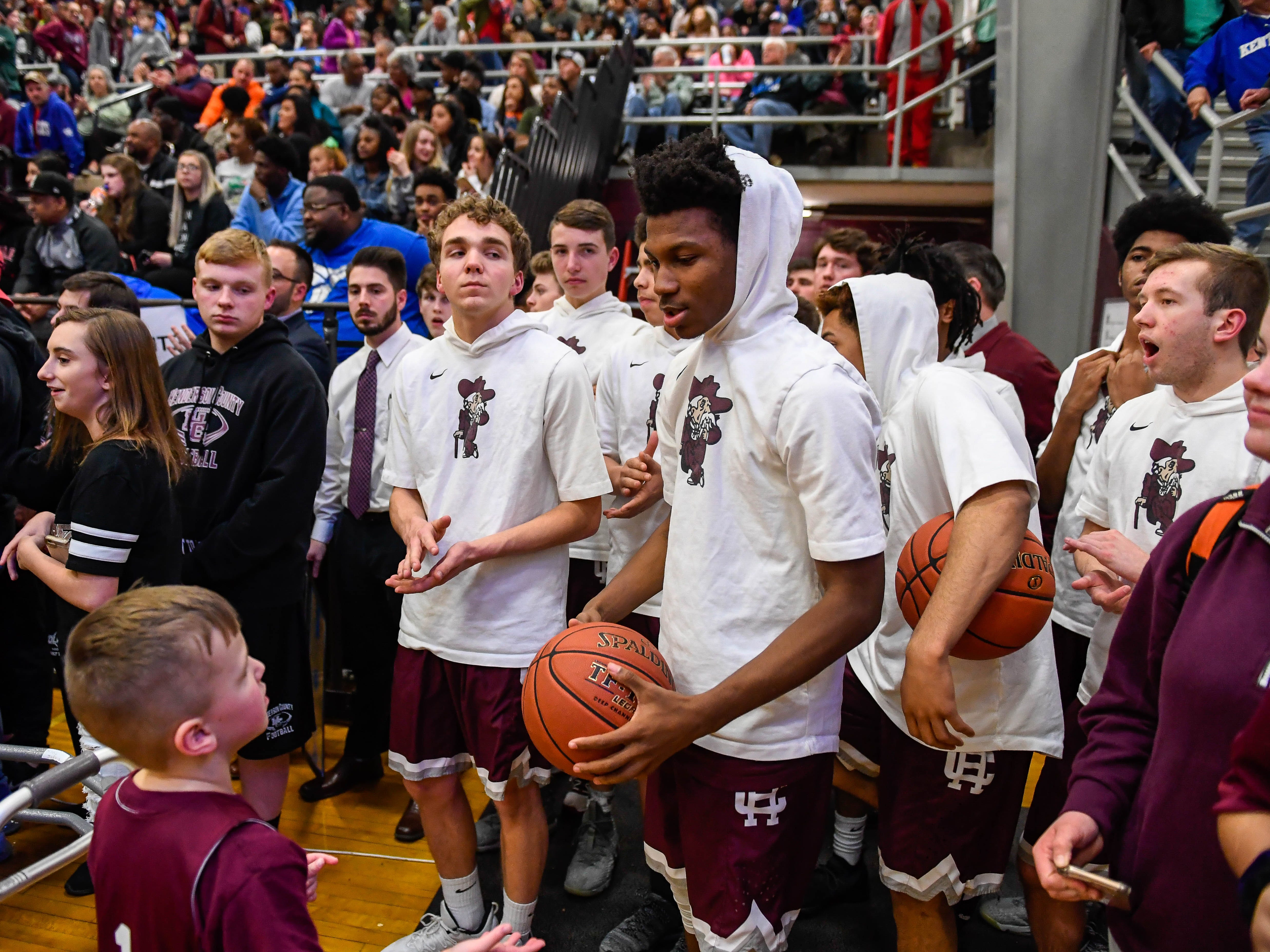 The Colonels wait to take the floor as the Henderson County Colonels play the Madisonville Maroons in the Boys 2nd Region basketball semi-finals Friday in Hansen, March 1, 2019.