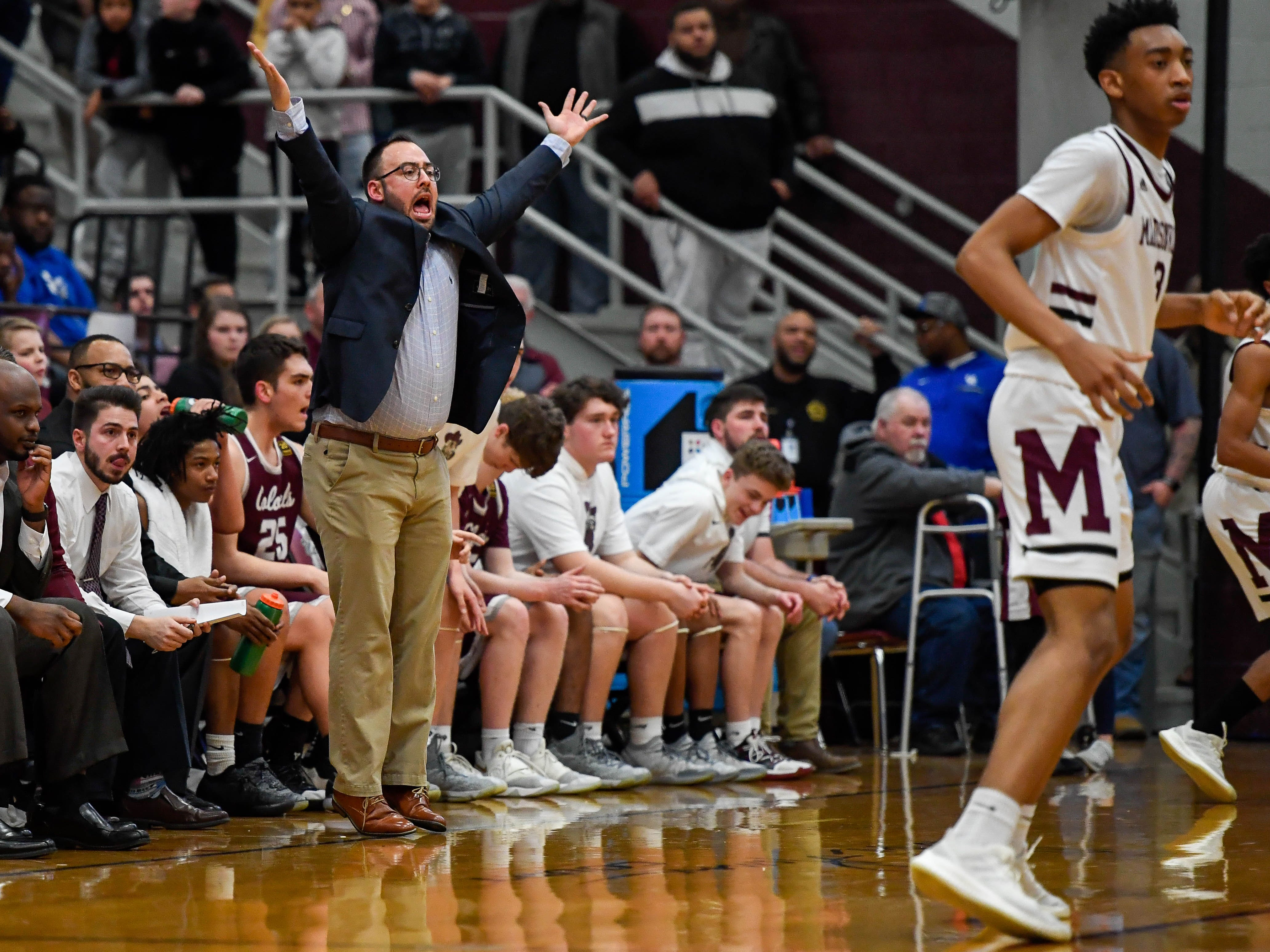 Henderson Head Coach Tyler Smithart reacts to action on the floor as the Henderson County Colonels play the Madisonville Maroons in the Boys 2nd Region basketball semi-finals Friday in Hansen, March 1, 2019.
