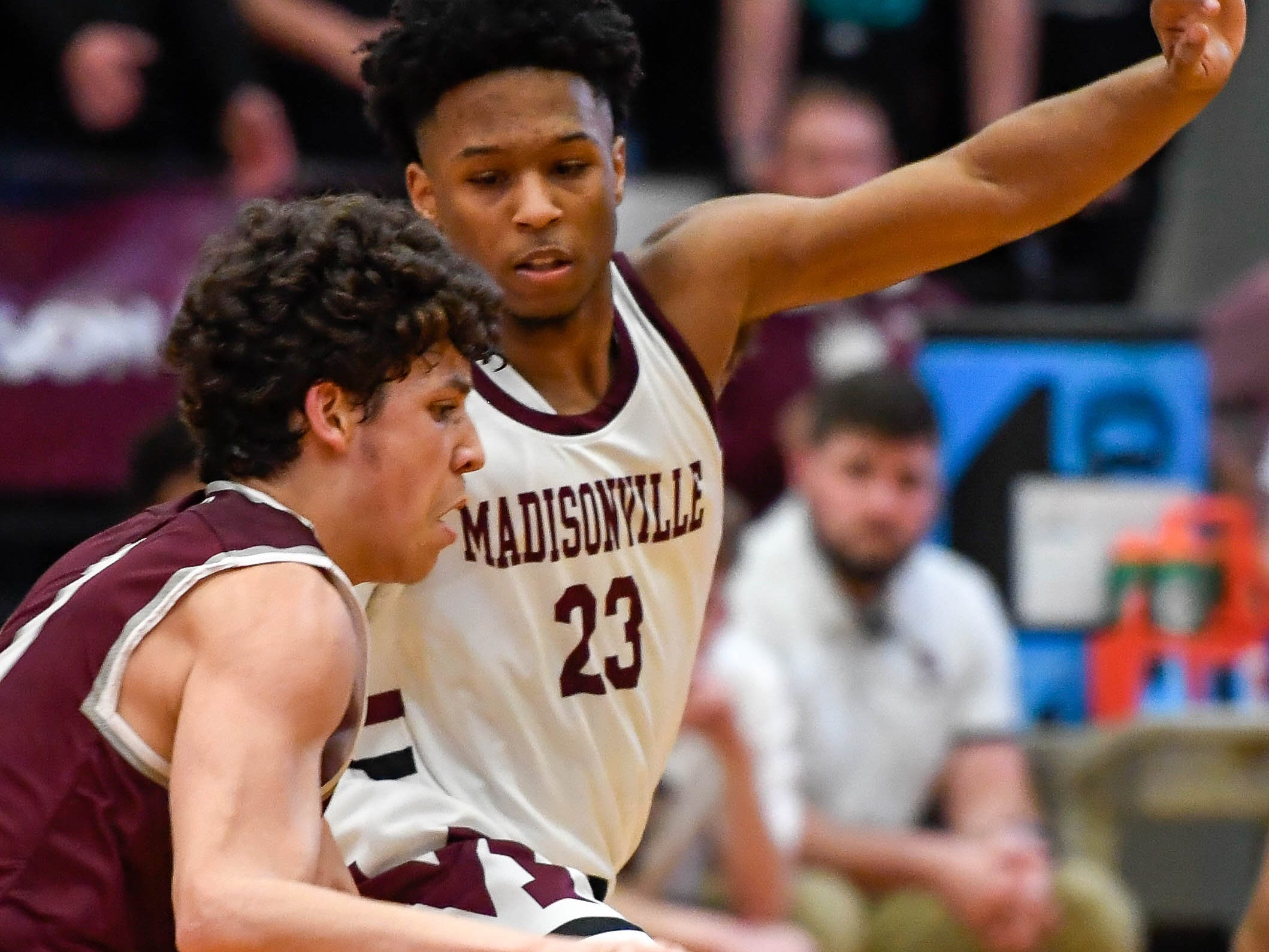 Henderson's Corey Stewart (1) drives  against Madisonville's Marquise Parker (23) as the Henderson County Colonels play the Madisonville Maroons in the Boys 2nd Region basketball semi-finals Friday in Hansen, March 1, 2019.