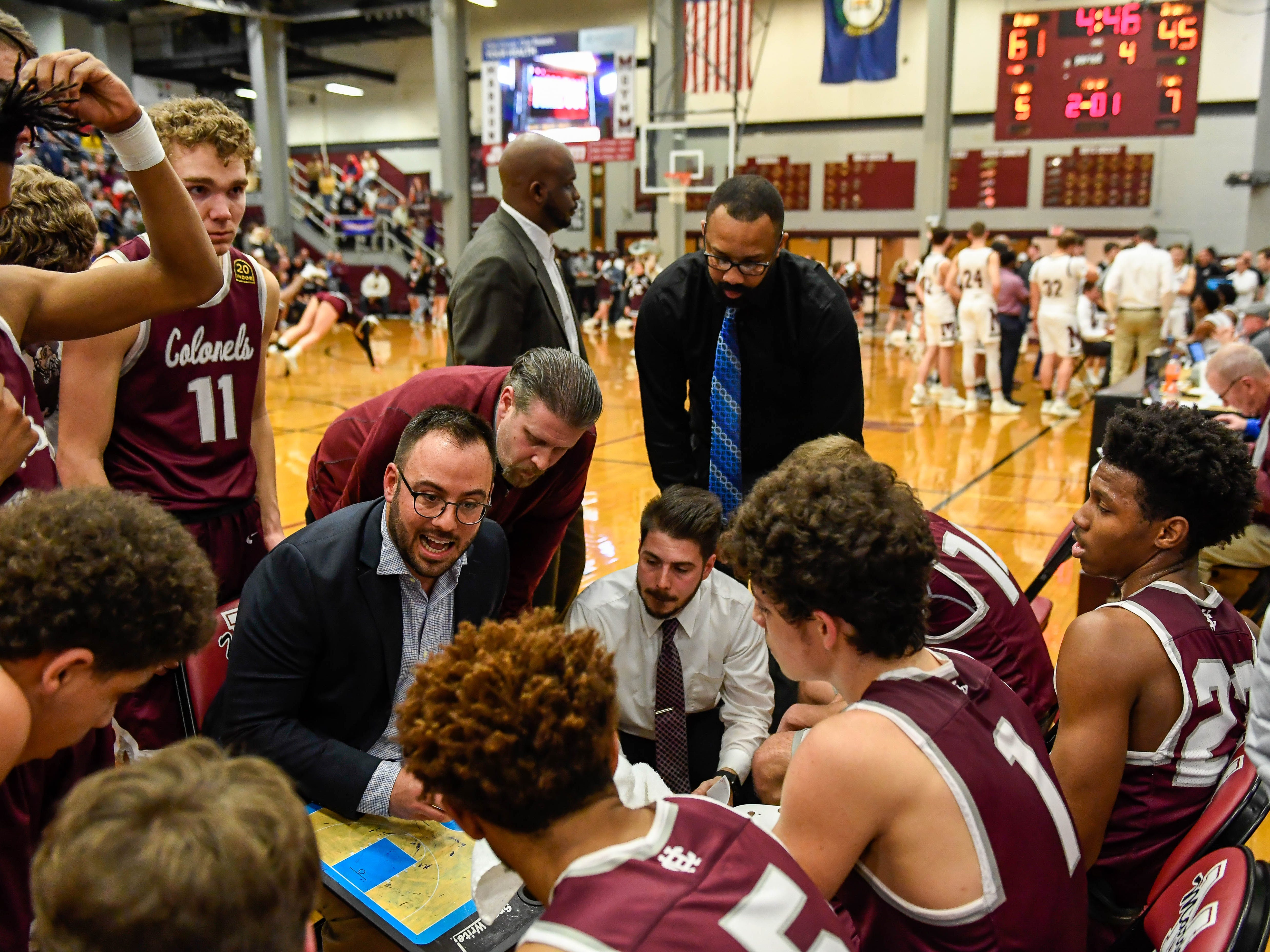 Sixteen points down with 4:46 on clock Henderson Head Coach Tyler Smithart talks to this team during a time-out as the Henderson County Colonels play the Madisonville Maroons in the Boys 2nd Region basketball semi-finals Friday in Hansen, March 1, 2019.