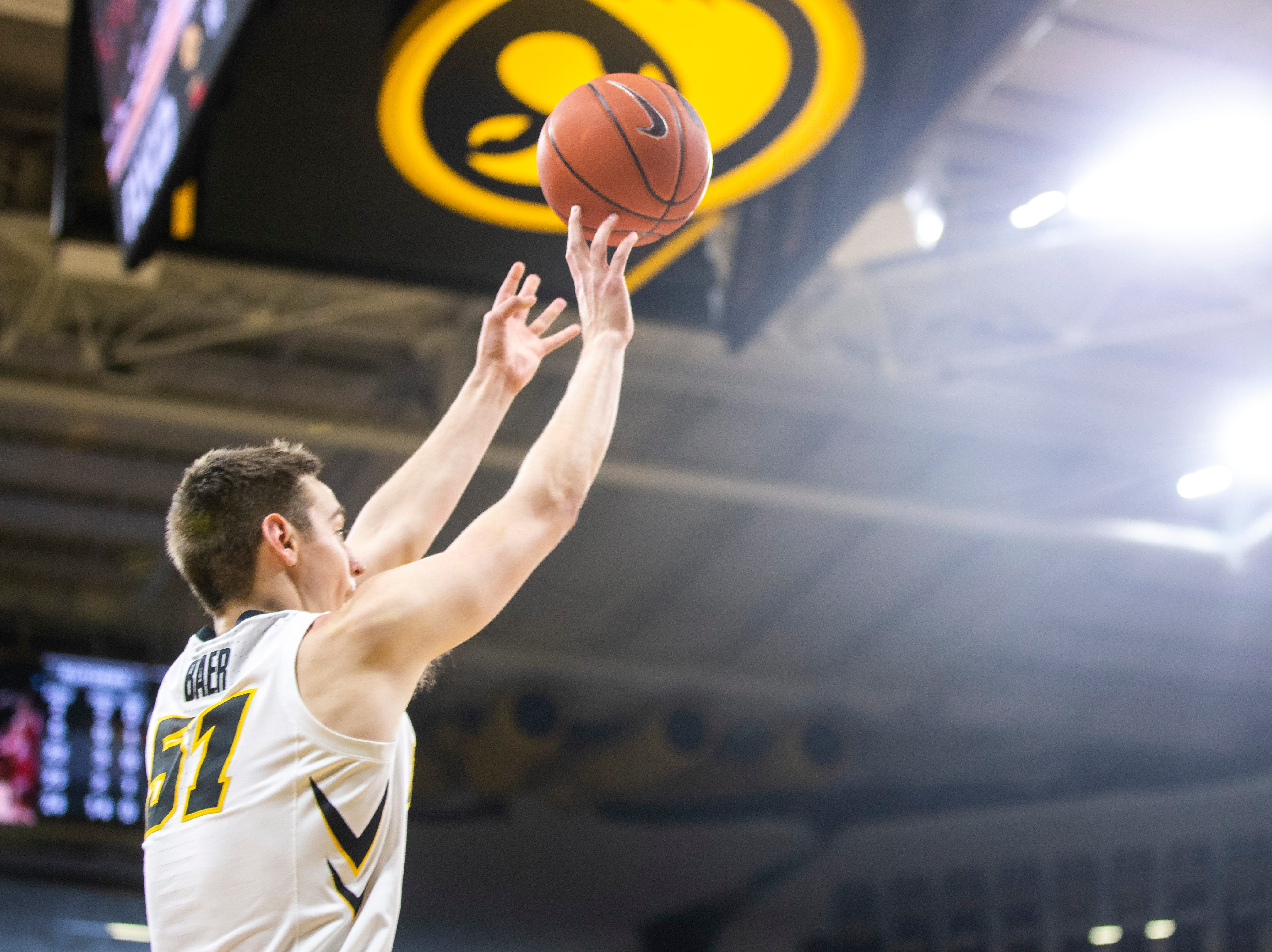 Iowa forward Nicholas Baer (51) shoots a basket during a NCAA Big Ten Conference men's basketball game on Saturday, March 2, 2019, at Carver-Hawkeye Arena in Iowa City, Iowa.