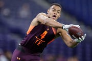 Iowa tight end Noah Fant runs a drill at the NFL football scouting combine in Indianapolis, Saturday, March 2, 2019. (AP Photo/Michael Conroy)