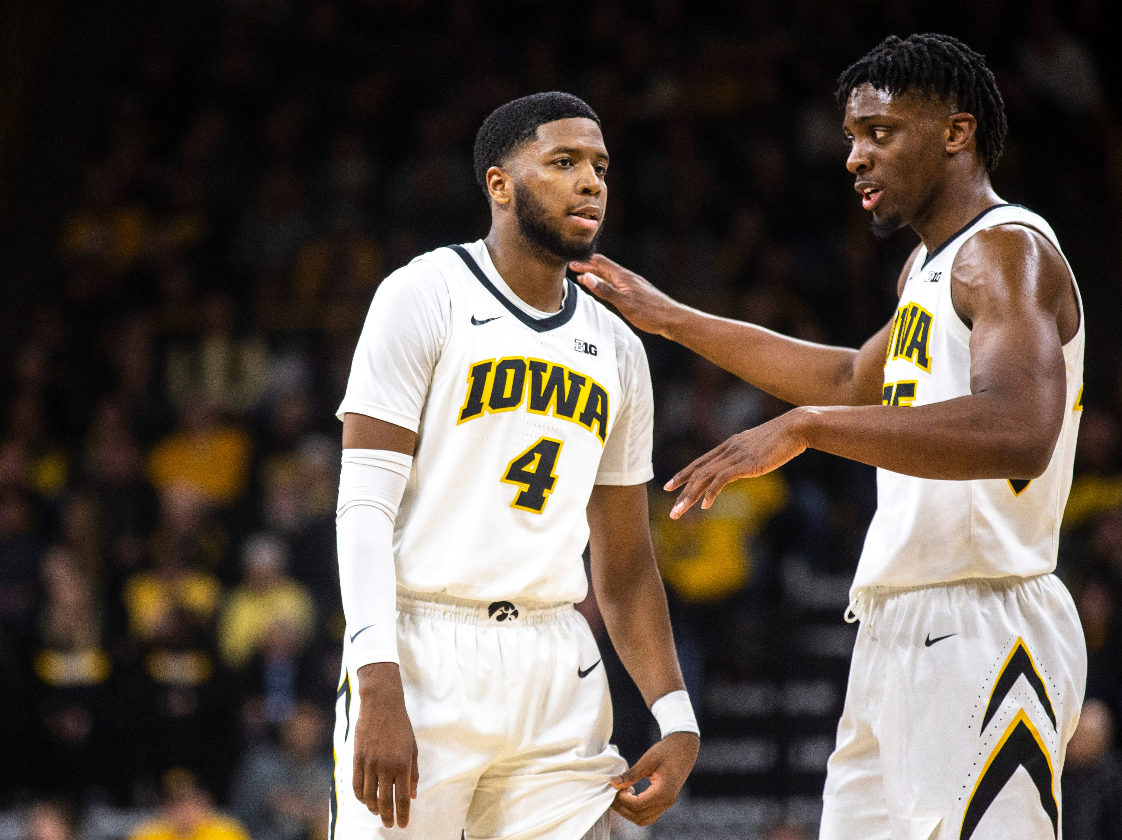 Iowa forward Tyler Cook, right, talks with Iowa guard Isaiah Moss (4) during a NCAA Big Ten Conference men's basketball game on Saturday, March 2, 2019, at Carver-Hawkeye Arena in Iowa City, Iowa.