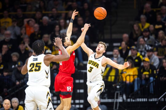 Iowa guard Jordan Bohannon (3) gets his shot blocked by Rutgers guard Geo Baker (0) during a NCAA Big Ten Conference men's basketball game on Saturday, March 2, 2019, at Carver-Hawkeye Arena in Iowa City, Iowa.