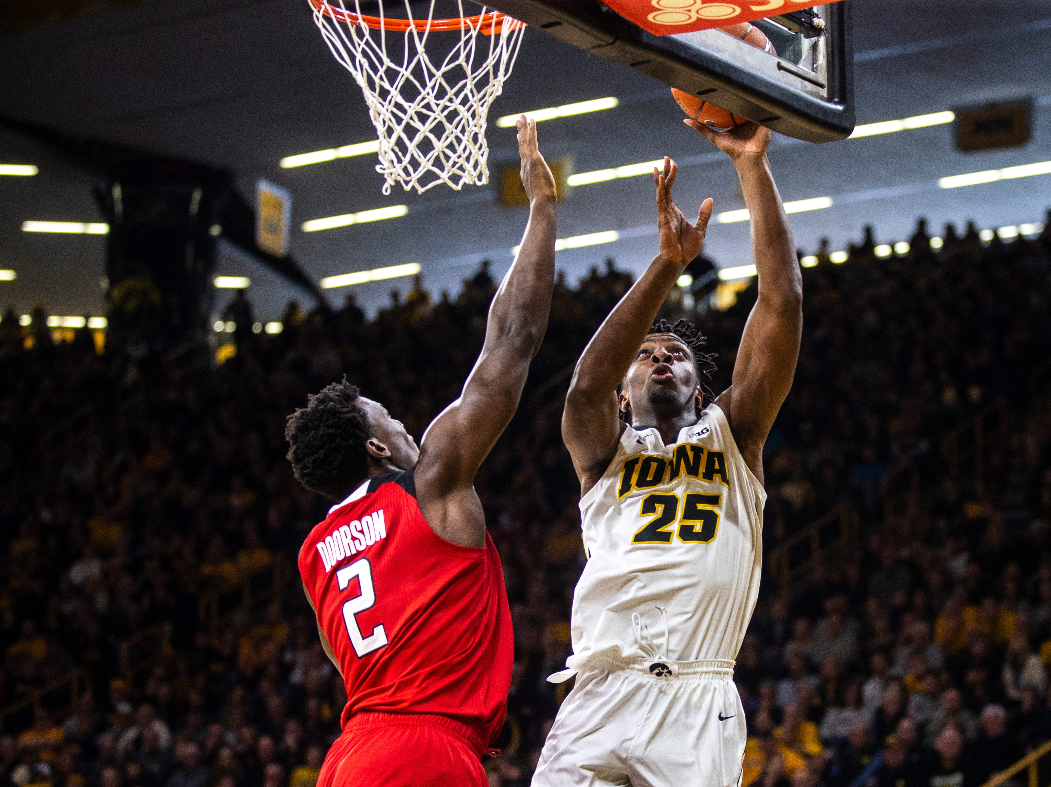 Iowa forward Tyler Cook (25) shoots a basket while Rutgers center Shaquille Doorson (2) defends during a NCAA Big Ten Conference men's basketball game on Saturday, March 2, 2019, at Carver-Hawkeye Arena in Iowa City, Iowa.