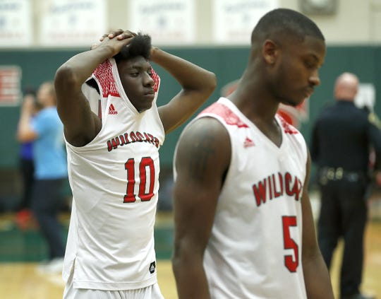 Dejected Lawrence North Wildcats Shamar Avance (10) walks off the court after falling to the Warren Central Warriors in the first half of their game at Lawrence North High School on Friday, Mar 1, 2019. The Warren Central Warriors defeated the Lawrence North Wildcats 27-25.