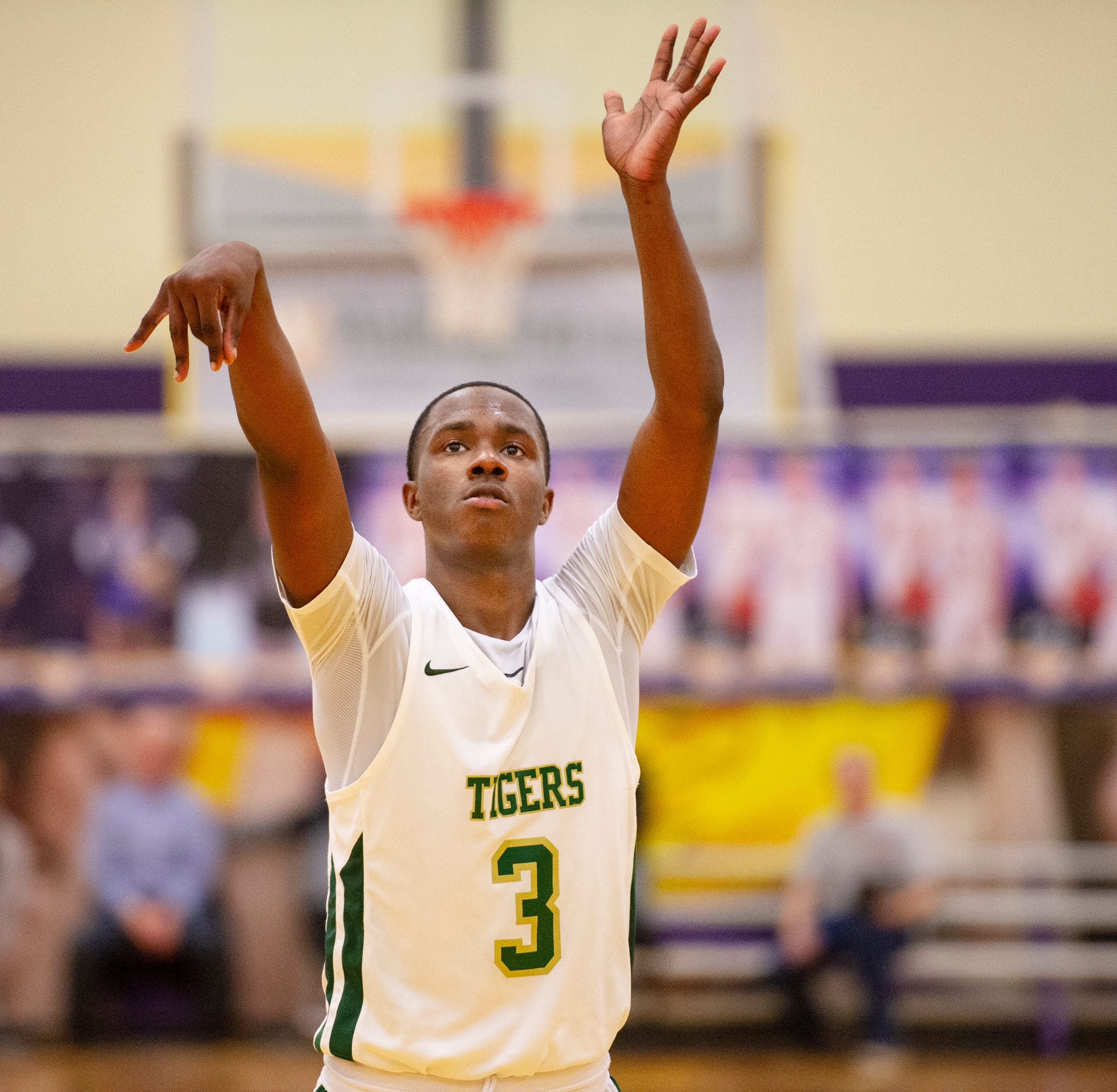 Indianapolis Crispus Attucks junior Sincere McMahon (3) shoots a free-throw late in the game during the second half of an IHSAA Class 3A Boys' Basketball Sectional semifinal game at Guerin Catholic High School in Noblesville, Ind., Friday, March 1, 2019. Indianapolis Crispus Attucks won 59-56.