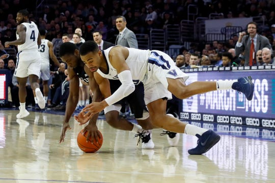 Villanova's Phil Booth, right, and Butler's Kamar Baldwin chase after a loose ball during the second half of an NCAA college basketball game, Saturday, March 2, 2019, in Philadelphia. Villanova won 75-54.
