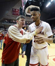 A fan celebrates with Indiana Hoosiers forward Juwan Morgan (13) after defeating Michigan State at Simon Skjodt Assembly Hall in Bloomington, Ind., on Saturday, March 2, 2019.