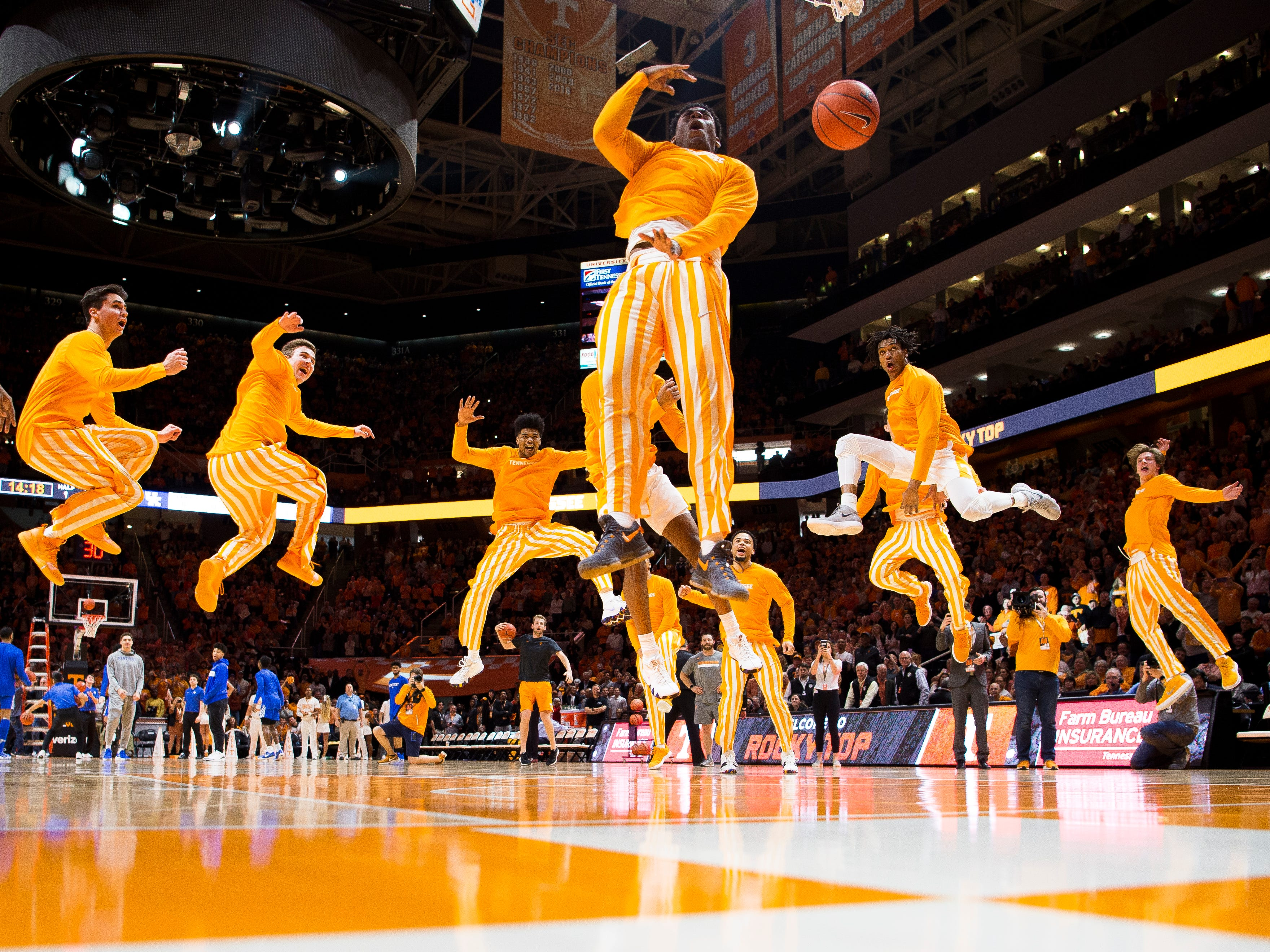 "Tennessee guard Admiral Schofield (5) takes the dunk for the ""One Fly, We All Fly"" pregame tradition before Tennessee's home basketball game against Kentucky at Thompson-Boling Arena in Knoxville on Saturday, March 2, 2019."