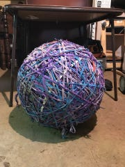 Shawn Banks' giant rubber band ball sits in his Alcoa home's basement.