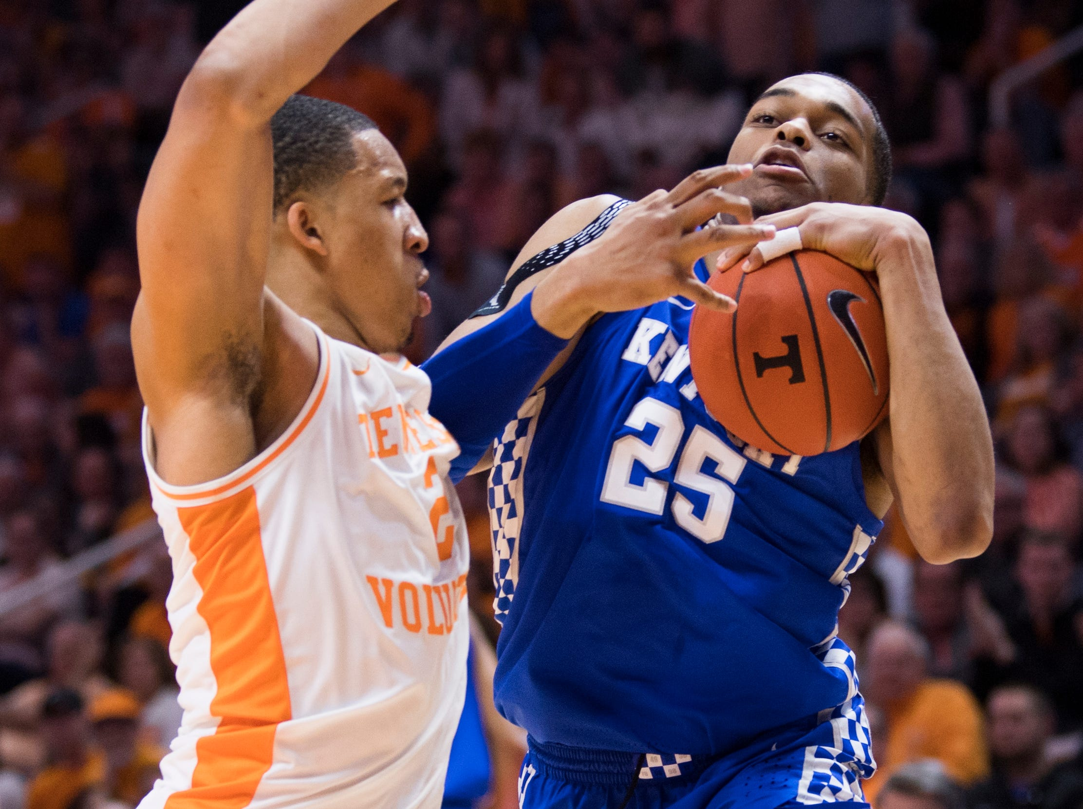 Tennessee forward Grant Williams (2) folds Kentucky PJ Washington (25) during Tennessee's home basketball game against Kentucky at Thompson-Boling Arena in Knoxville on Saturday, March 2, 2019.