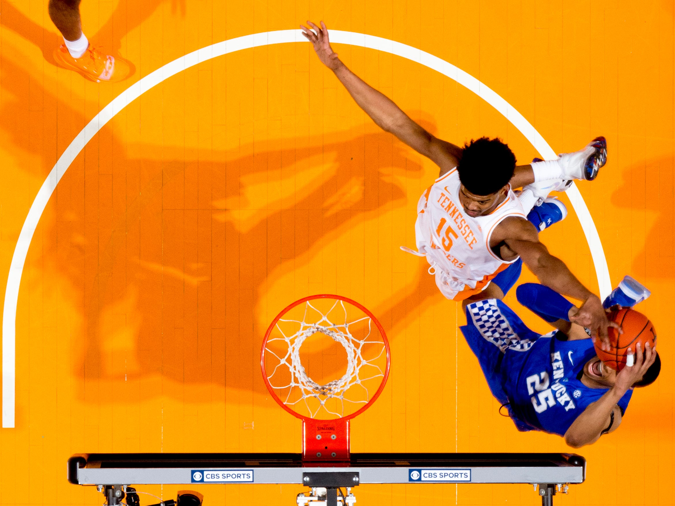 Tennessee forward Derrick Walker (15) blocks a shot by Kentucky PJ Washington (25) during a game between Tennessee and Kentucky at Thompson-Boling Arena in Knoxville, Tennessee on Saturday, March 2, 2019.