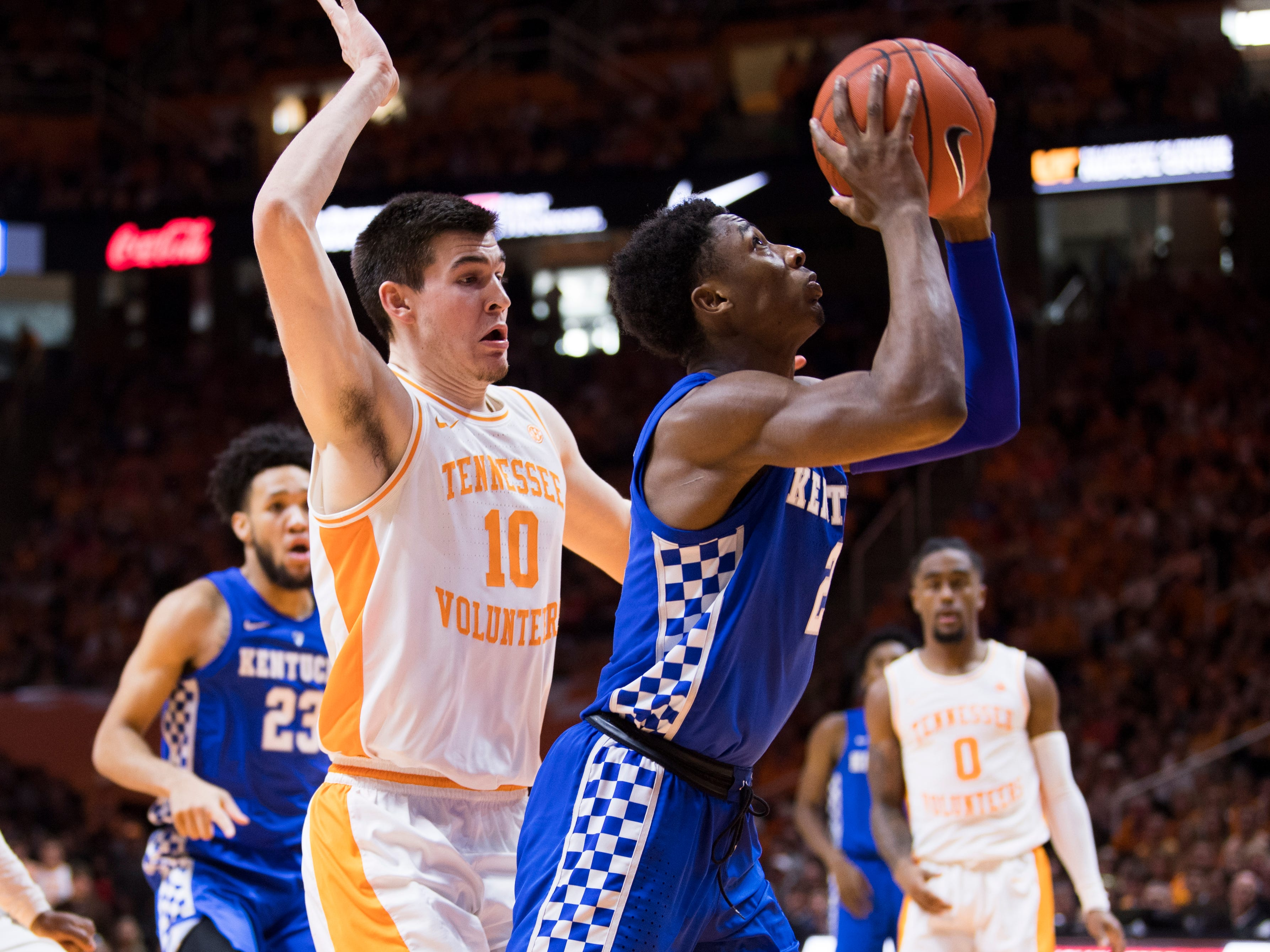 Tennessee forward John Fulkerson (10) defends Kentucky guard Ashton Hagans (2) during Tennessee's home basketball game against Kentucky at Thompson-Boling Arena in Knoxville on Saturday, March 2, 2019.