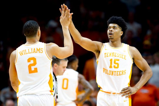 Tennessee forward Grant Williams (2) and Tennessee forward Derrick Walker (15) celebrate a point during a game between Tennessee and Kentucky at Thompson-Boling Arena in Knoxville, Tennessee on Saturday, March 2, 2019.