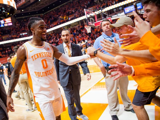 Tennessee guard Jordan Bone (0) high fives fans after Tennessee's home basketball game against Kentucky at Thompson-Boling Arena in Knoxville on Saturday, March 2, 2019.