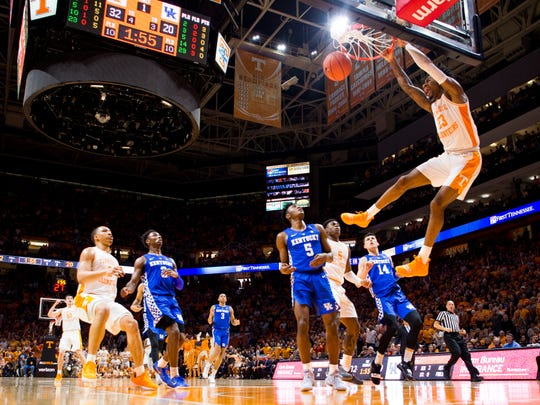Tennessee guard Jordan Bowden (23) makes a dunk during Tennessee's home basketball game against Kentucky at Thompson-Boling Arena in Knoxville on Saturday, March 2, 2019.