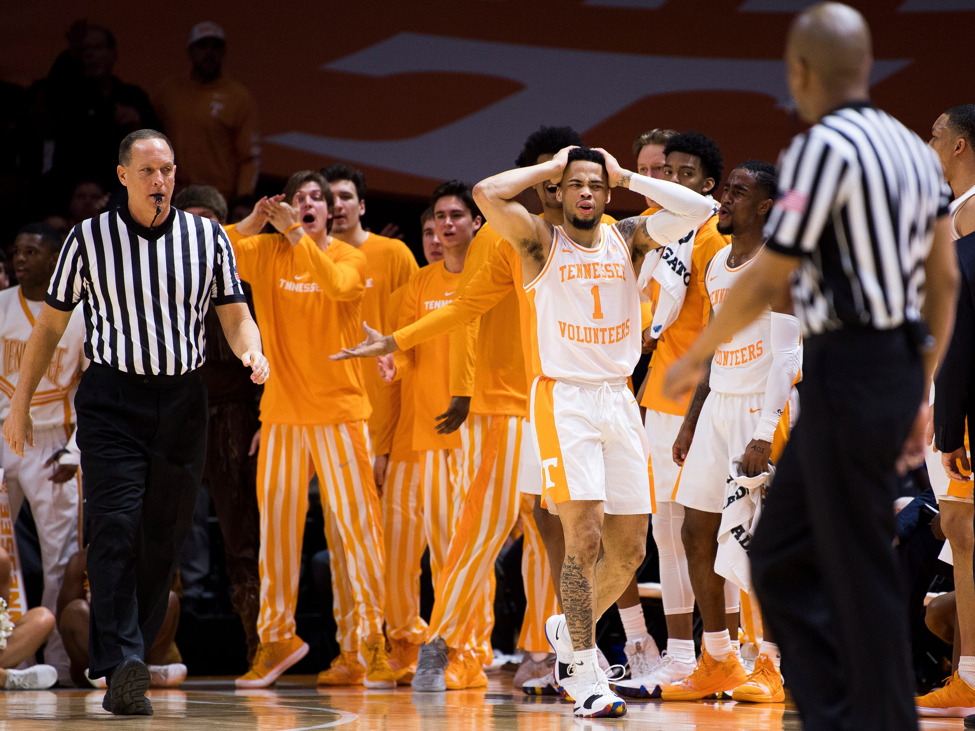 Tennessee guard Lamonte Turner (1) and the Tennessee bench reacts to a foul called against Turner during Tennessee's home basketball game against Kentucky at Thompson-Boling Arena in Knoxville on Saturday, March 2, 2019.
