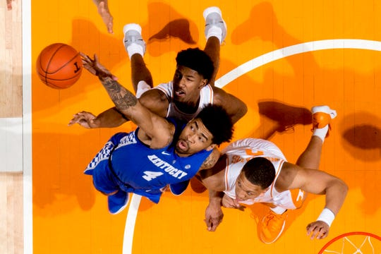 Kentucky's Nick Richards battles Tennessee's Kyle Alexander and Grant Williams for a rebound at Thompson-Boling Arena in Knoxville on March 2. The Wildcats and Vols will be among the top contenders in this week's SEC Tournament in Nashville.