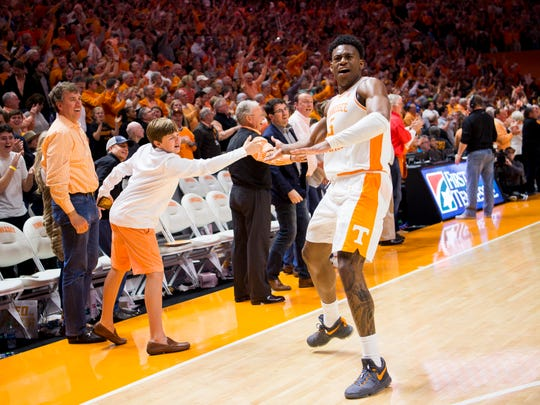 Tennessee guard Admiral Schofield (5) runs down the court gives high fives to fans after Tennessee's home basketball game against Kentucky at Thompson-Boling Arena in Knoxville on Saturday, March 2, 2019.