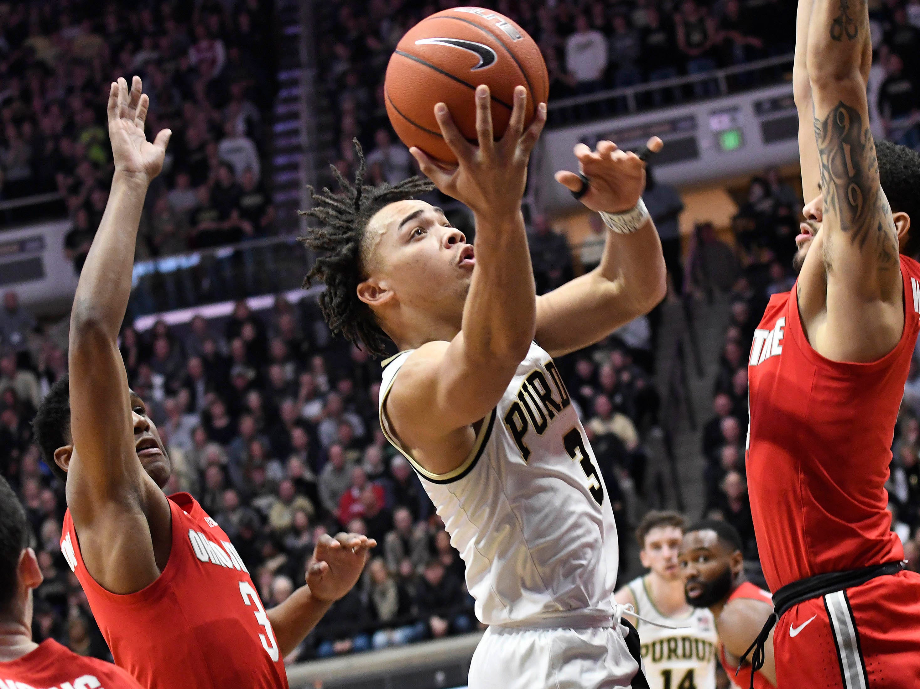Mar 2, 2019; West Lafayette, IN, USA; Purdue Boilermakers guard Carsen Edwards (3) splits the defense as he goes to the basket in the first half at Mackey Arena. Mandatory Credit: Sandra Dukes-USA TODAY Sports