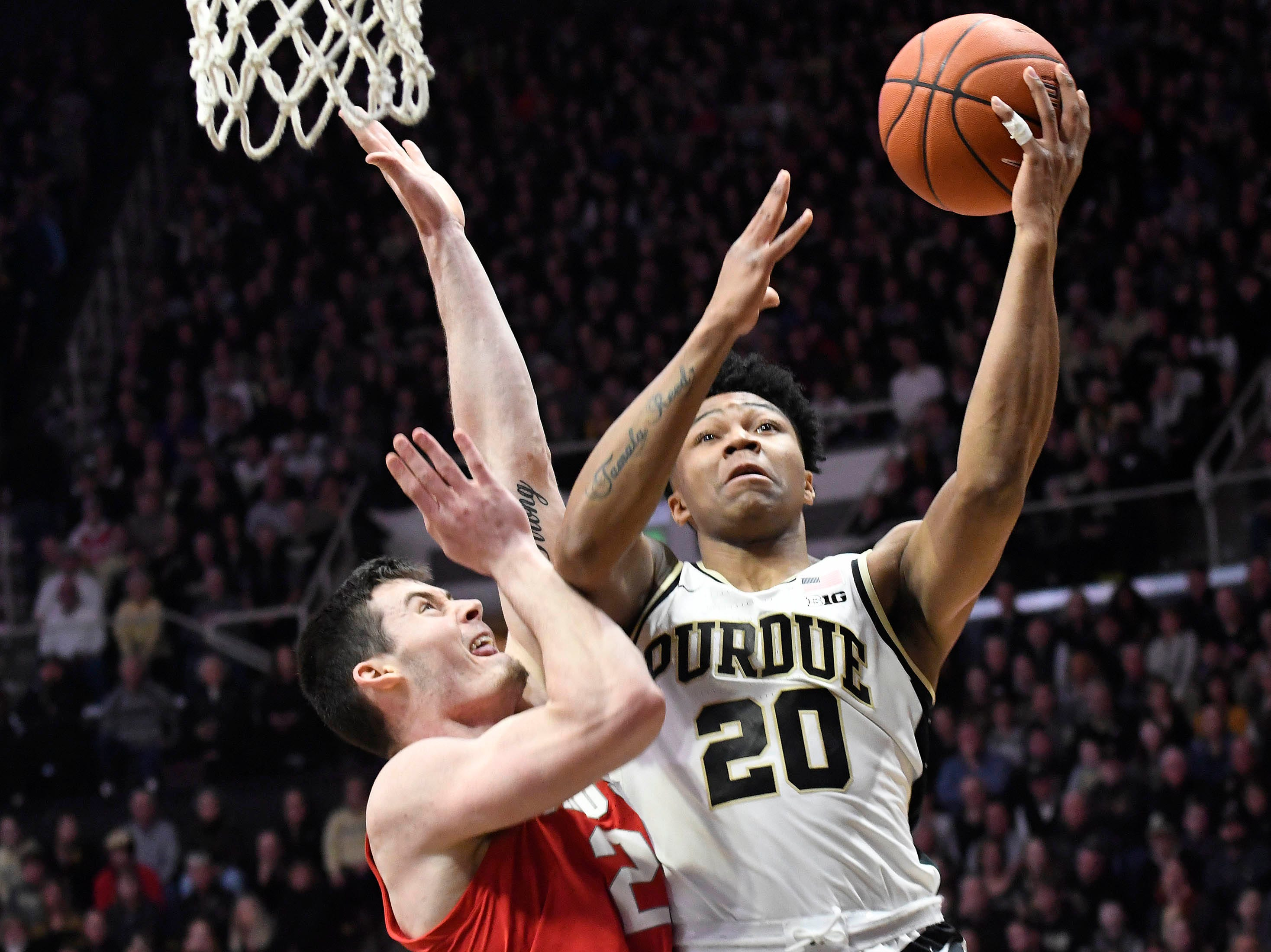 Mar 2, 2019; West Lafayette, IN, USA; Purdue Boilermakers guard Nojel Eastern (20) drives past the defense or a shot  in the first half at Mackey Arena. Mandatory Credit: Sandra Dukes-USA TODAY Sports