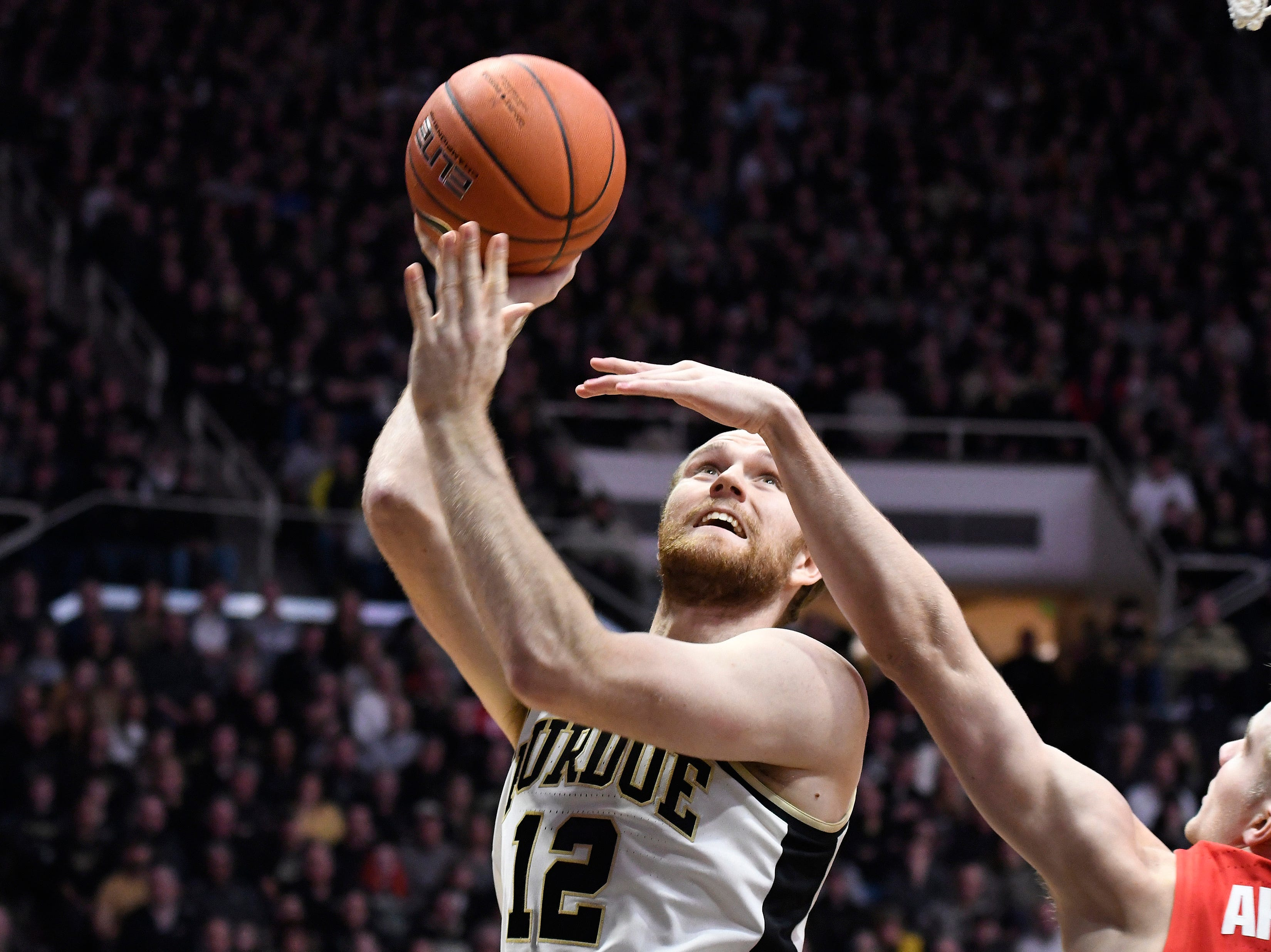 Mar 2, 2019; West Lafayette, IN, USA; Purdue Boilermakers forward Evan Boudreaux (12) drives past the defender for a layup in the 2nd half at Mackey Arena. Mandatory Credit: Sandra Dukes-USA TODAY Sports