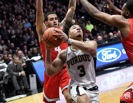 Mar 2, 2019; West Lafayette, IN, USA; Purdue Boilermakers guard Carsen Edwards (3) drives past Ohio State Buckeyes guard Duane Washington Jr. (4) in the 2nd half at Mackey Arena. Mandatory Credit: Sandra Dukes-USA TODAY Sports