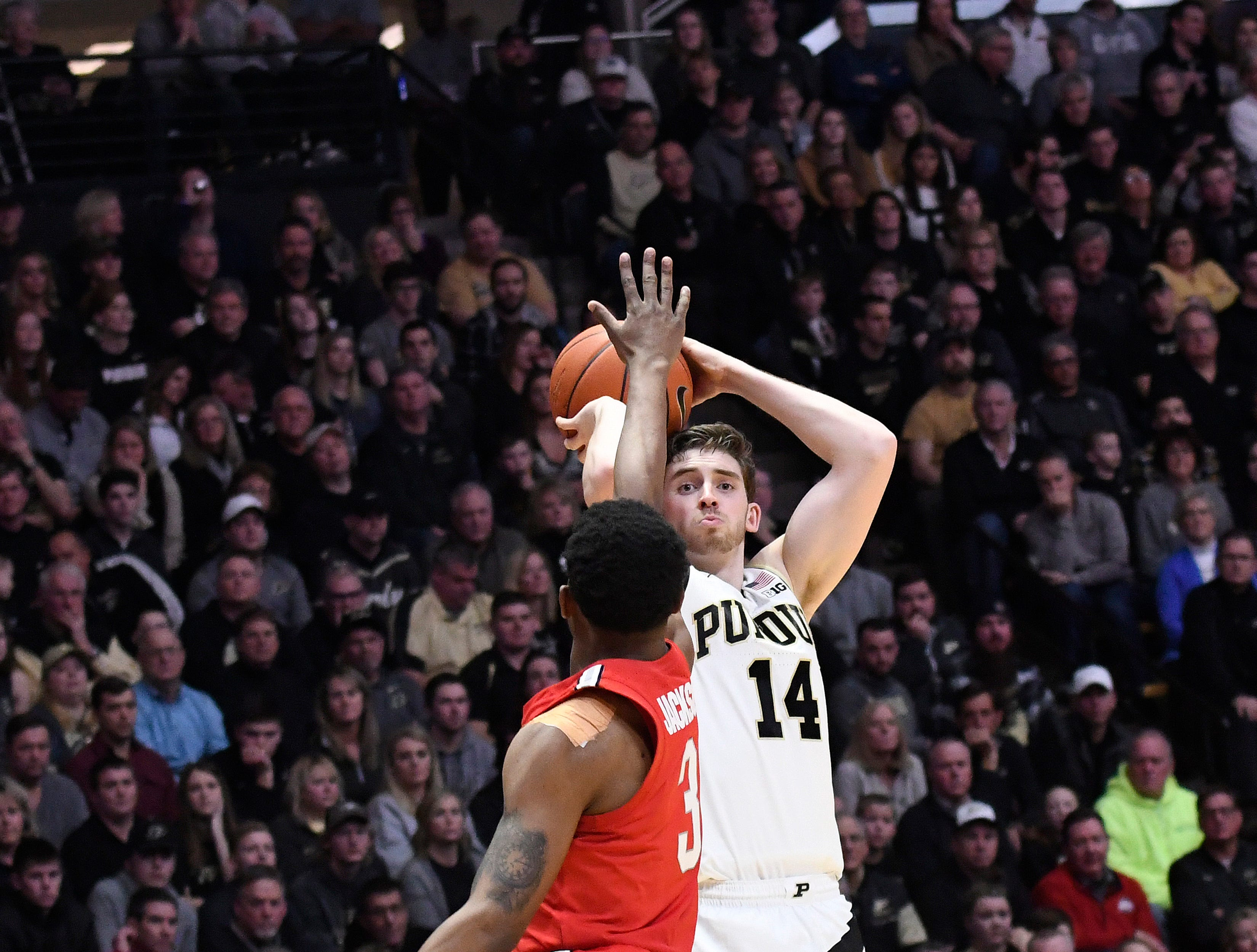 Mar 2, 2019; West Lafayette, IN, USA; Purdue Boilermakers guard Ryan Cline (14) readies to release a shot over an Ohio State Buckeye defender in the 2nd half at Mackey Arena. Mandatory Credit: Sandra Dukes-USA TODAY Sports