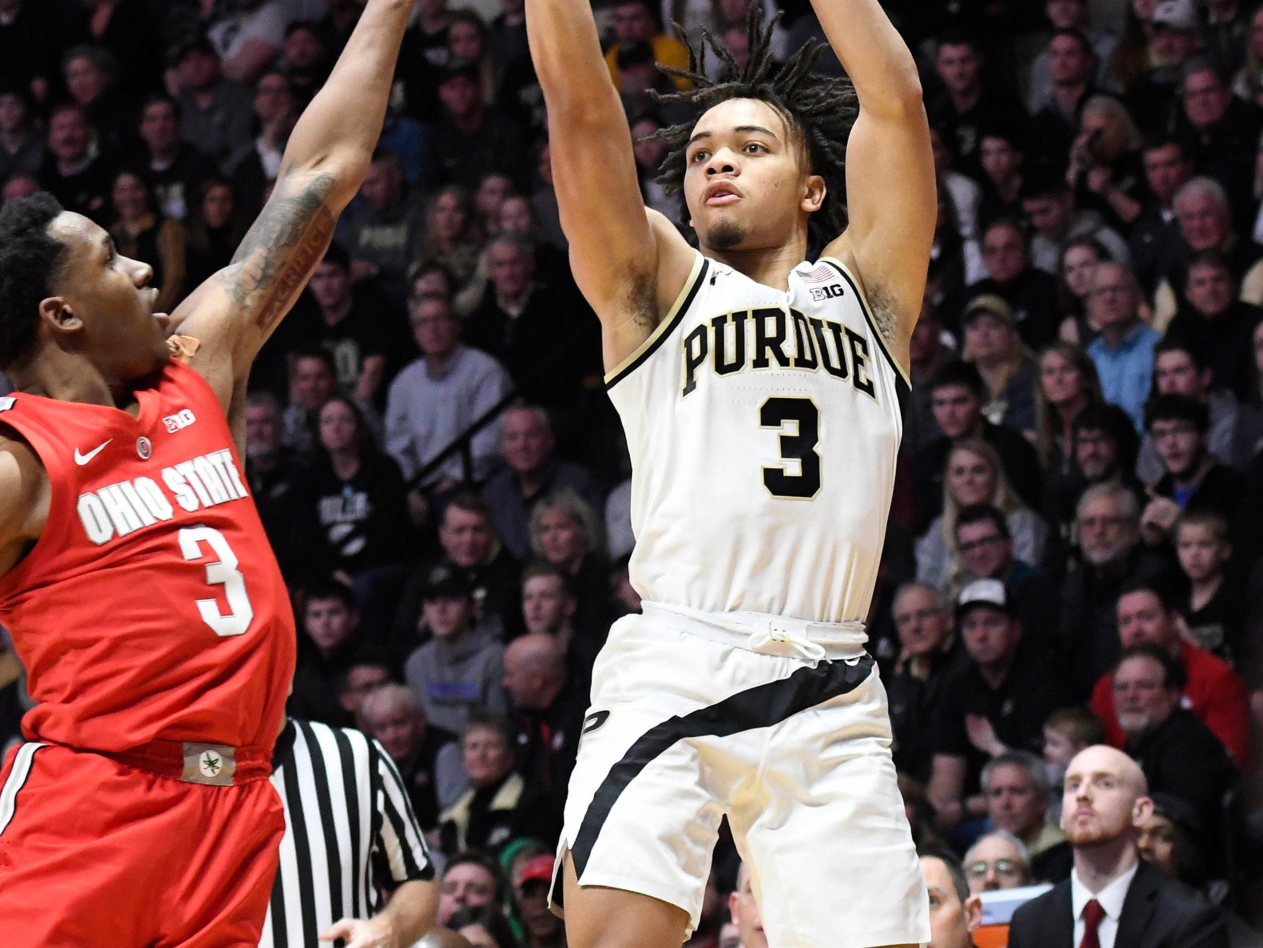 Mar 2, 2019; West Lafayette, IN, USA; Purdue Boilermakers guard Carsen Edwards (3) fires a shot over Ohio State Buckeye guard CJ Jackson in the first half at Mackey Arena. Mandatory Credit: Sandra Dukes-USA TODAY Sports