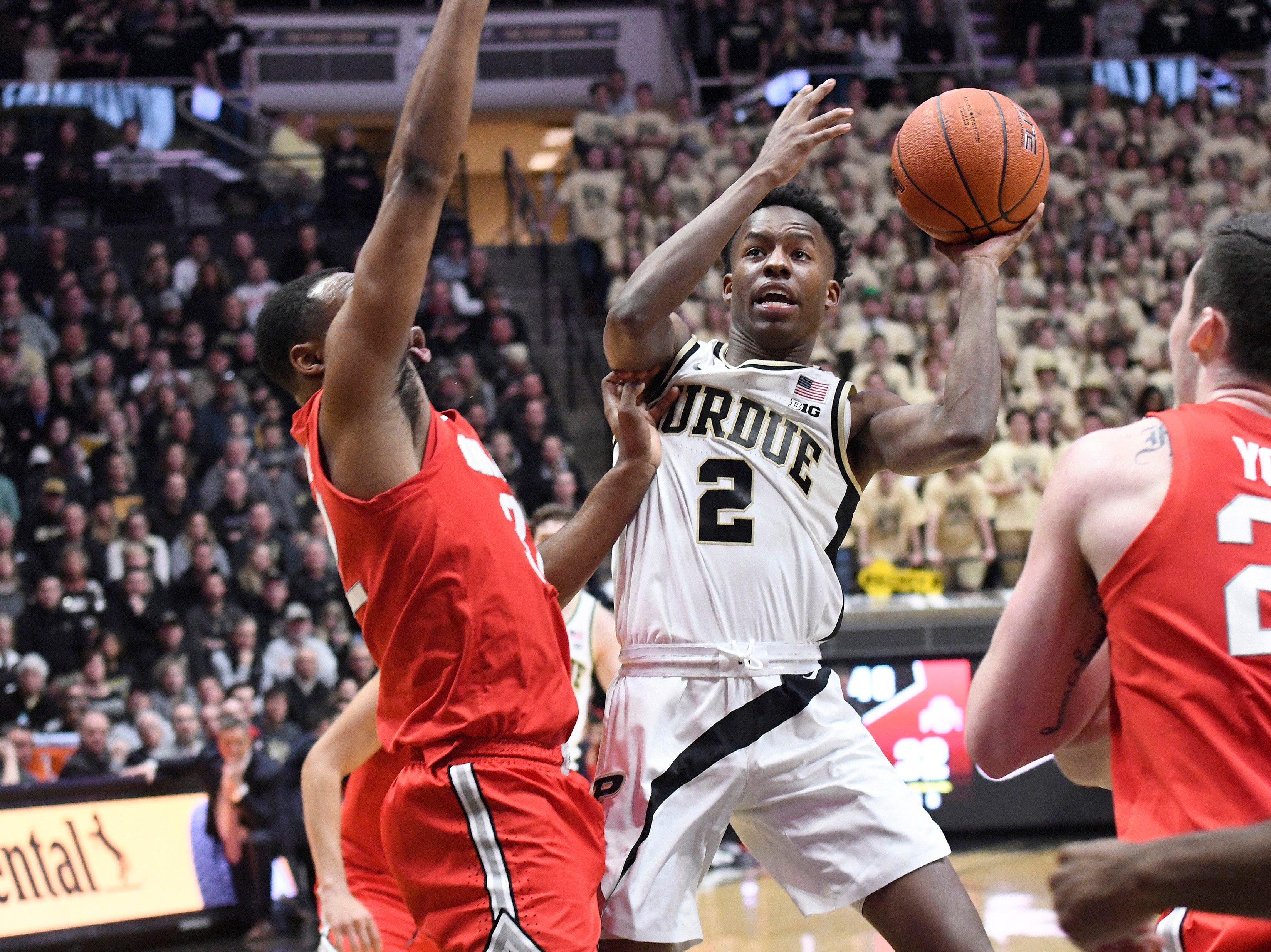 Mar 2, 2019; West Lafayette, IN, USA; Purdue Boilermakers guard Eric Hunter Jr. (2) drives or a shot past the Ohio State Buckeye defenders in the 2nd half at Mackey Arena. Mandatory Credit: Sandra Dukes-USA TODAY Sports
