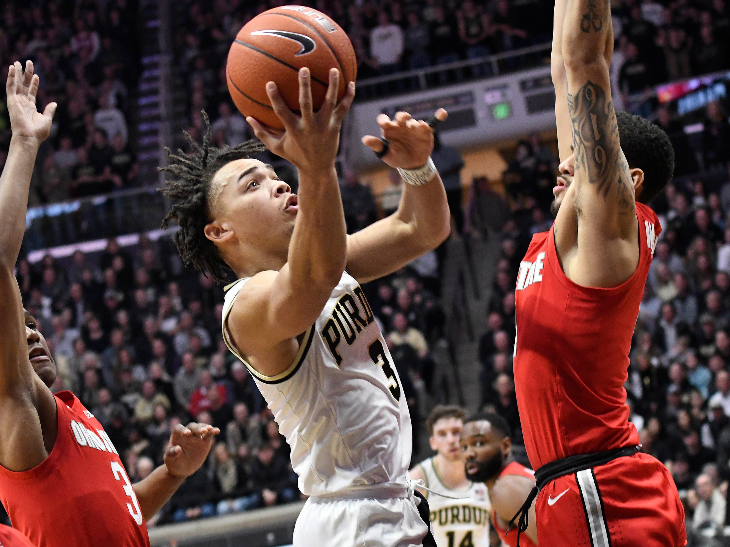 Purdue Boilermakers guard Carsen Edwards (3) splits the defense as he goes to the basket in the first half at Mackey Arena.