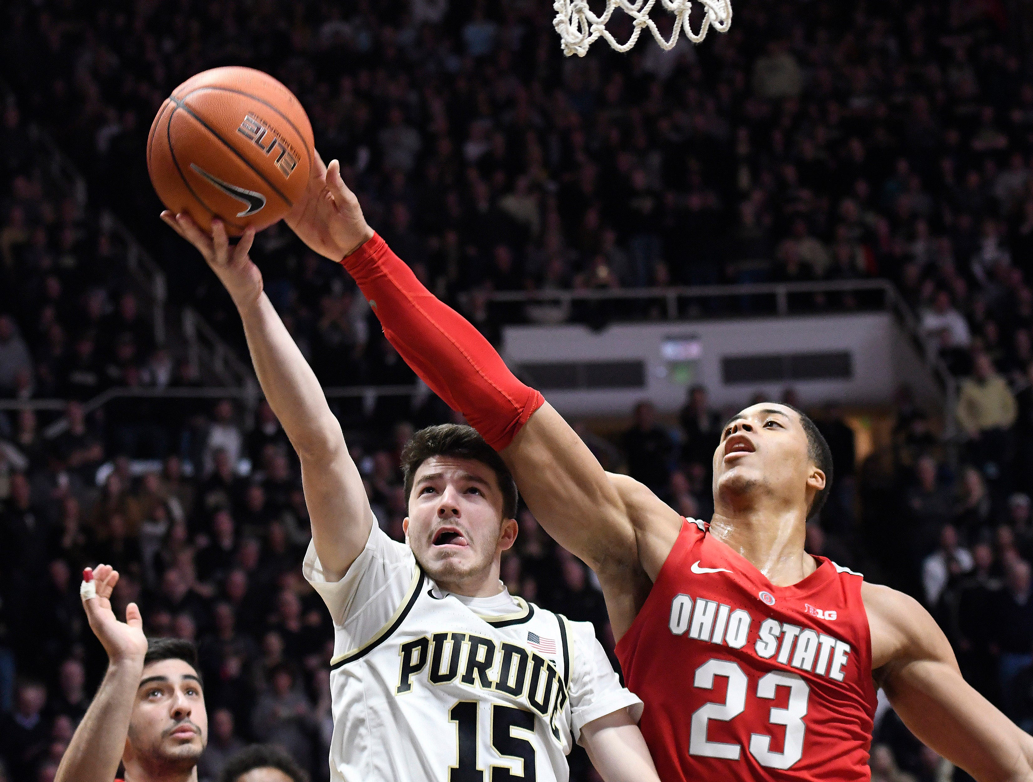 Mar 2, 2019; West Lafayette, IN, USA; Purdue Boilermakers guard Tommy Luce (15) goes for a layup which is swatted away by Ohio State Buckeyes forward Jaedon LeDee (23) in the 2nd half at Mackey Arena. Mandatory Credit: Sandra Dukes-USA TODAY Sports