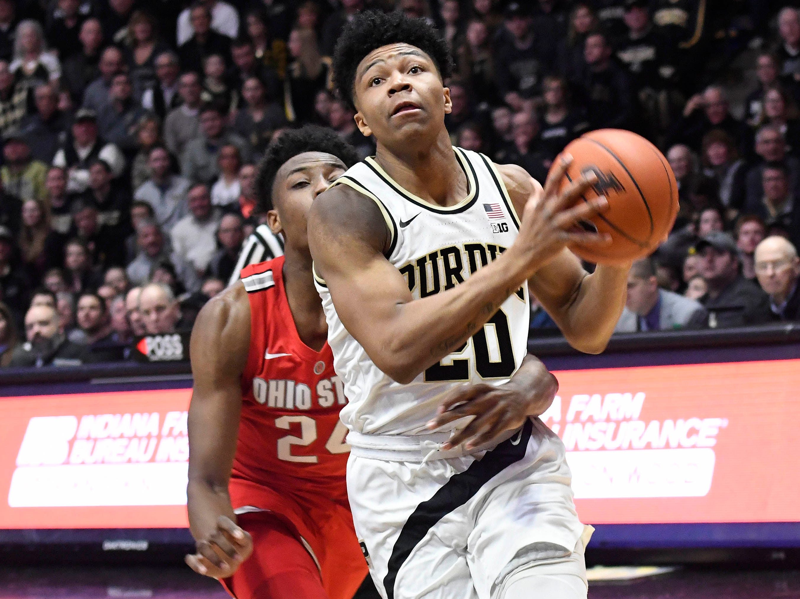 Mar 2, 2019; West Lafayette, IN, USA; Purdue Boilermakers guard Nojel Eastern (20) drives past Ohio State Buckeye guard Andre Wesson in the first half at Mackey Arena. Mandatory Credit: Sandra Dukes-USA TODAY Sports