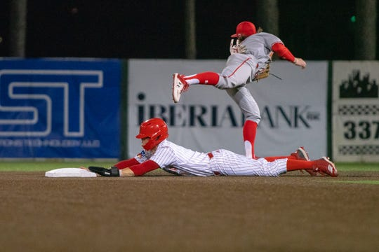 UL's Connor Dupuy slides to steal second base in Friday night's 4-2 loss to Maryland.