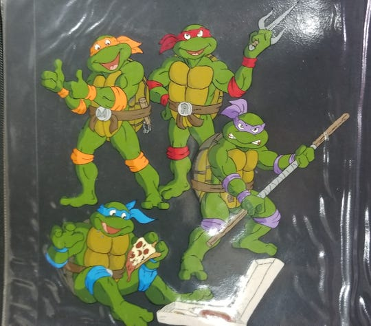 The four Teenage Mutant Ninja Turtles - from top left, Michelangelo, Raphael, Donatello and Leonardo, as painted by Deirdre Gogarty when she worked on the animated series