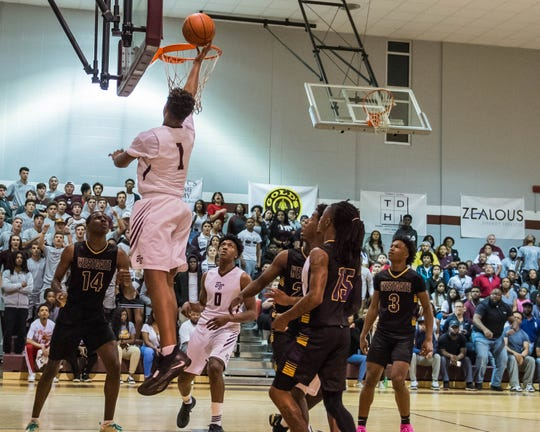 Breaux Bridge High's Trevonte Sylvester (1) makes an easy layup for two points as the Breaux Bridge Tigers host the Westgate Tigers in a Class 4A quarterfinal matchup on Friday, March 1, 2019.