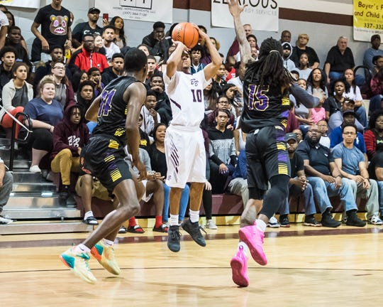 Breaux Bridge High's Seth Alexander (10) goes for a 3-point shot as the Breaux Bridge Tigers host the Westgate Tigers in a Class 4A quarterfinal matchup on Friday, March 1, 2019.