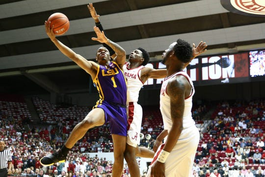 LSU guard Ja'vonte Smart fights for a shot over Alabama guard Kira Lewis Jr. on Saturday at Coleman Coliseum.
