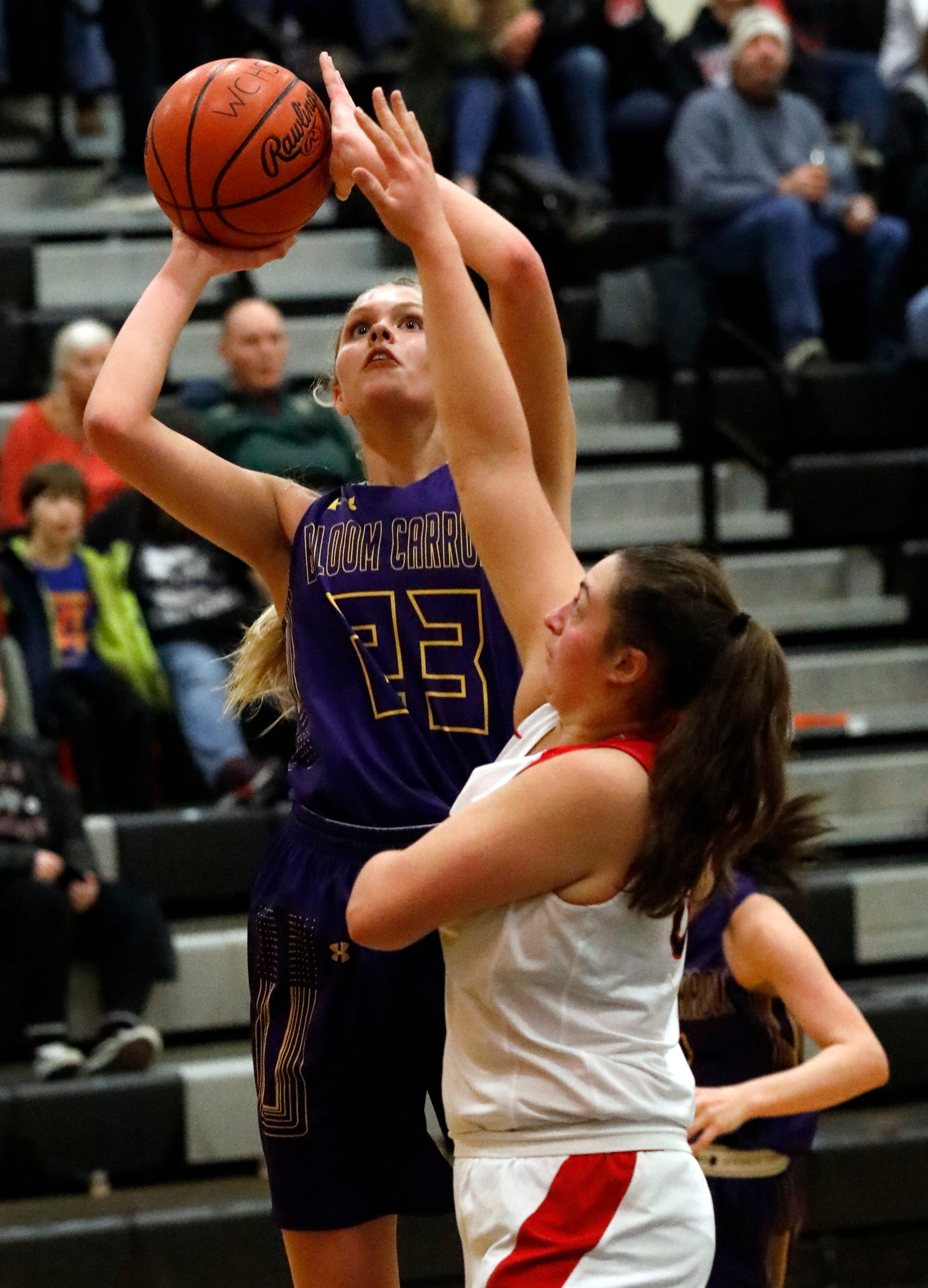 Bloom-Carroll's Chloe Davis takes a shot during Friday night's game, March 1, 2019, against Jonathan Alder at Westerville Central High School in Westerville. The Bulldogs won the game 69-57.