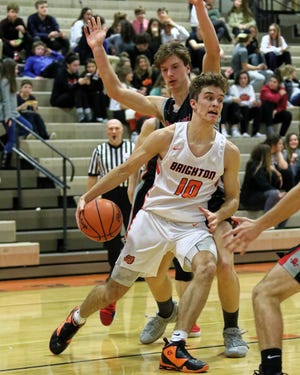 Keenan Stolz (10) scored 11 points for Brighton in a district championship game loss to Ann Arbor Skyline.