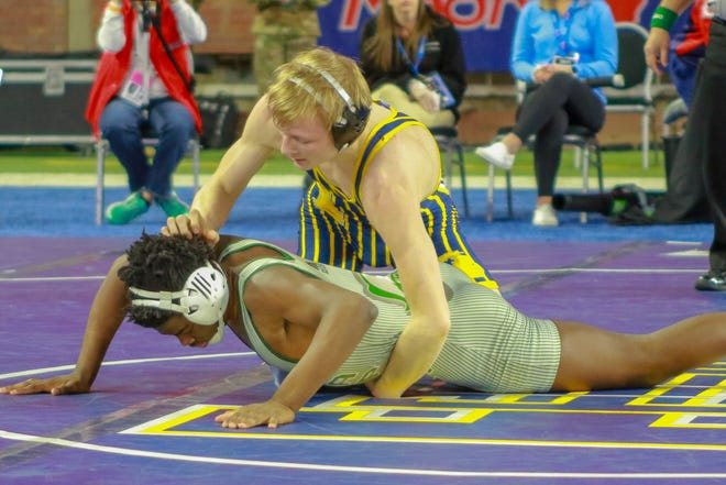 Hartland's Kyle Kantola completed a perfect season by winning the 130-pound state title at Ford Field on Saturday, March 2, 2019.