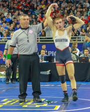 Eddie Homrock of Brighton celebrates his 125-pound state championship at Ford Field on Saturday, March 2, 2019.