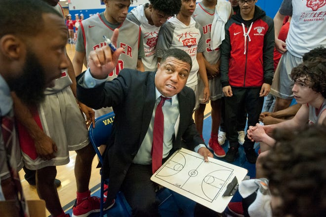 Butler head basketball coach Kentreal Goodin maps out the end-game during a late time-out in the Region 6 championship game.02 March 2019