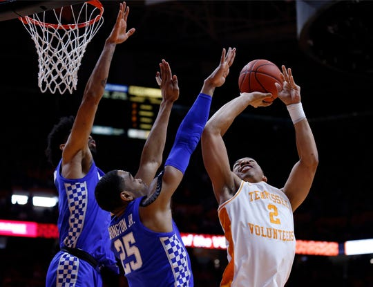 Tennessee forward Grant Williams (2) shoots as as Kentucky forward PJ Washington (25) and forward Nick Richards (4) defend during the first half of an NCAA college basketball game Saturday, March 2, 2019, in Knoxville, Tennessee.