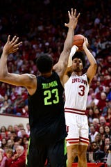 Justin Smith shoots over MSU's Xavier Tillman in the first half in Bloomington, Ind.