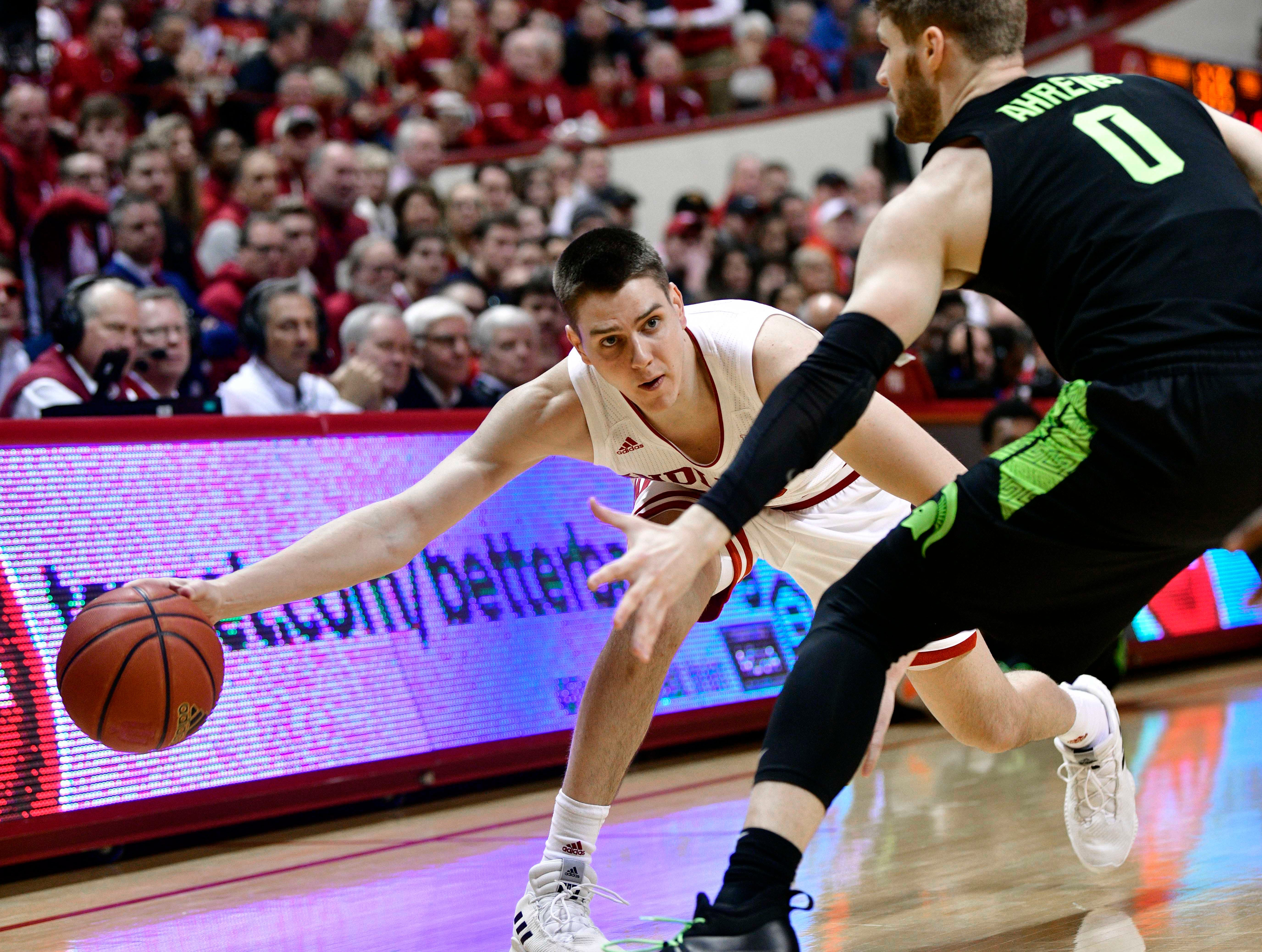 Mar 2, 2019; Bloomington, IN, USA; Indiana Hoosiers guard Zach McRoberts (15) attempts to pass the ball past Michigan State Spartans forward Kyle Ahrens (0) during the first half of the game at Assembly Hall. Mandatory Credit: Marc Lebryk-USA TODAY Sports