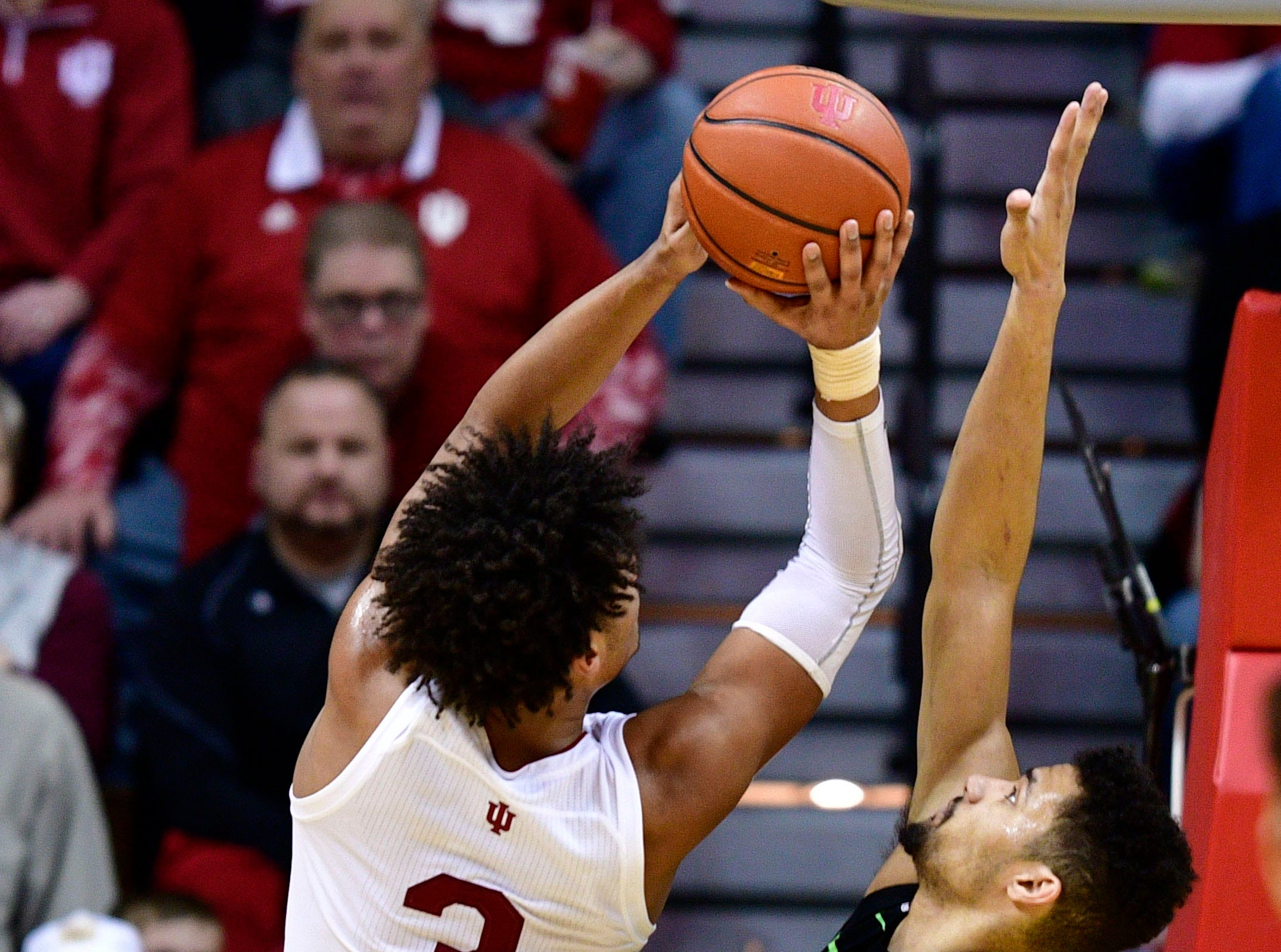 Mar 2, 2019; Bloomington, IN, USA; Michigan State Spartans forward Kenny Goins (25) attempts to block a shot by Indiana Hoosiers forward Justin Smith (3) during the second half of the game at Assembly Hall.The Indiana Hoosiers defeated the Michigan State Spartans at the last second 63 to 62. Mandatory Credit: Marc Lebryk-USA TODAY Sports
